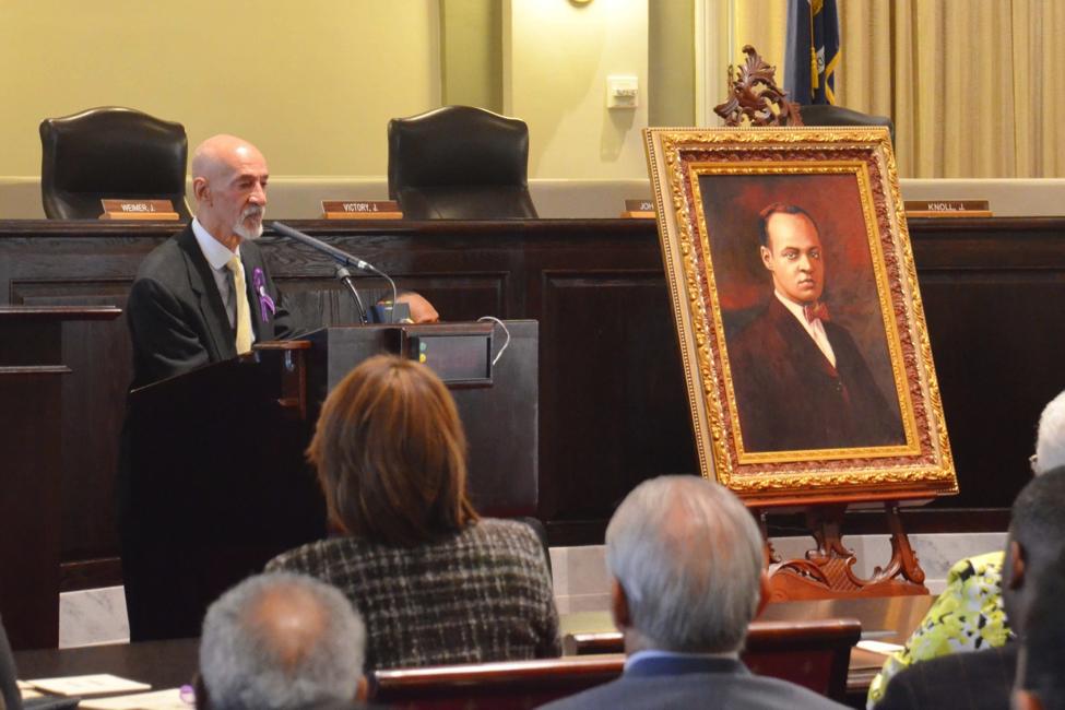 A.P. Tureaud, Jr. addresses the audience during the portrait presentation ceremony.